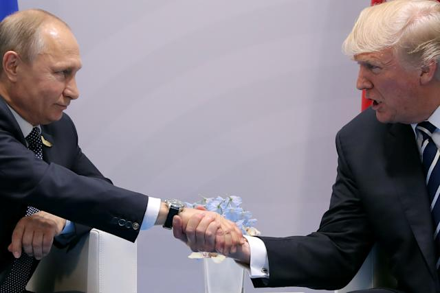 Trump shakes hands with Russian President Vladimir Putin during the their bilateral meeting at the G-20 summit in Hamburg, Germany, on July 7, 2017.  (Carlos Barria / Reuters)