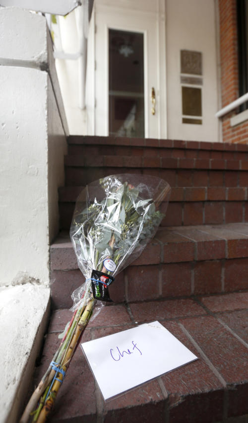 A card addressed to Chef, and a bouquet of flowers rest on the stairs to Charlie Trotter's permanently closed Chicago restaurant after reports of the chef's death Tuesday, Nov. 5, 2013, in Chicago. Trotter, 54, an award-winning chef, was a self-taught culinary master whose eponymous Chicago restaurant elevated the city's cuisine and provided a training ground for some of the nation's other best chefs. (AP Photo/Charles Rex Arbogast)