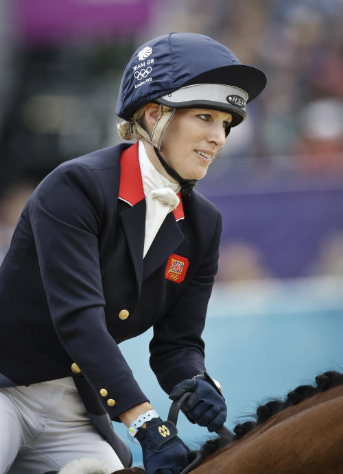 FILE - Britain's Zara Phillips and her horse High Kingdom compete in the show-jumping phase of the equestrian eventing competition at the 2012 Summer Olympics, in this file photo dated Tuesday, July 31, 2012, at Greenwich Park in London. Buckingham Palace announced Friday Jan, 17, 2014, that Queen Elizabeth II's granddaughter Zara Phillips and husband Mike Tindall have given birth to a 7 pounds, 12 ounces (3.5 kilograms) baby girl at Gloucestershire Royal Hospital. (AP Photo/Markus Schreiber, FILE)