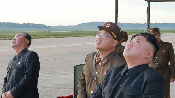 PHOTO: In this undated photo distributed on Sept. 16, 2017, by the North Korean government, leader Kim Jong Un, right, watches what was said to be the test launch of an intermediate range Hwasong-12 missile at an undisclosed location in North Korea. (Korean Central News Agency/Korea News Service via AP)