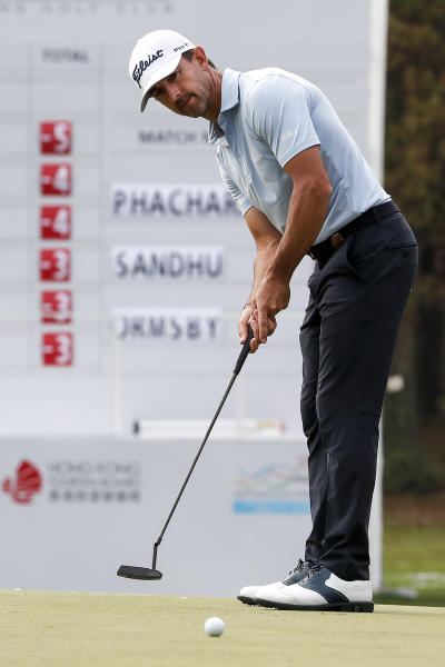 Wade Ormsby of Australia watches his putt on the 18th hole during the Hong Kong Open golf tournament at Fanling Golf Club in Hong Kong, Thursday, Jan. 9, 2020. (AP Photo/Andy Wong)