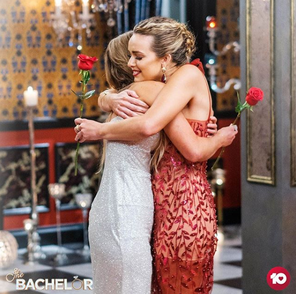 Abbie Chatfield and Chelsie McLeod embrace after the final rose ceremony on The Bachelor Australia 2019.