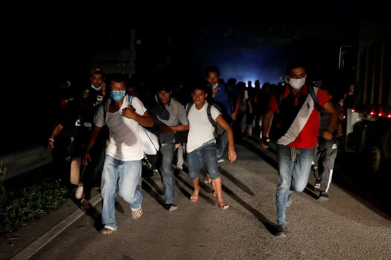 Guatemala sends over 3,000 Honduran migrants home from caravan