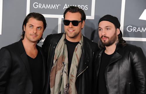 FILE - In a Feb. 10, 2013 file photo, Swedish House Mafia, from left, Axwell, Steve, Sebastian Ingrosso, and Steve Angello arrive at the 55th annual Grammy Awards, in Los Angeles. This year's Ultra Music Festival, which begins Friday, March 15, 2013, will feature the final performance of the Swedish House Mafia. (Photo by Jordan Strauss/Invision/AP, File)