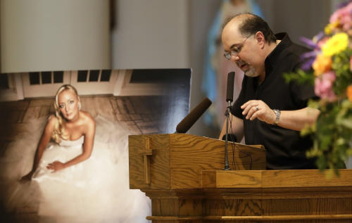 Recording executive Jimmy Nichols speaks during a memorial service for country singer Mindy McCready on Wednesday, March 6, 2013, in Nashville, Tenn. McCready committed suicide Feb. 17 in Heber Springs, Ark. (AP Photo/Mark Humphrey)