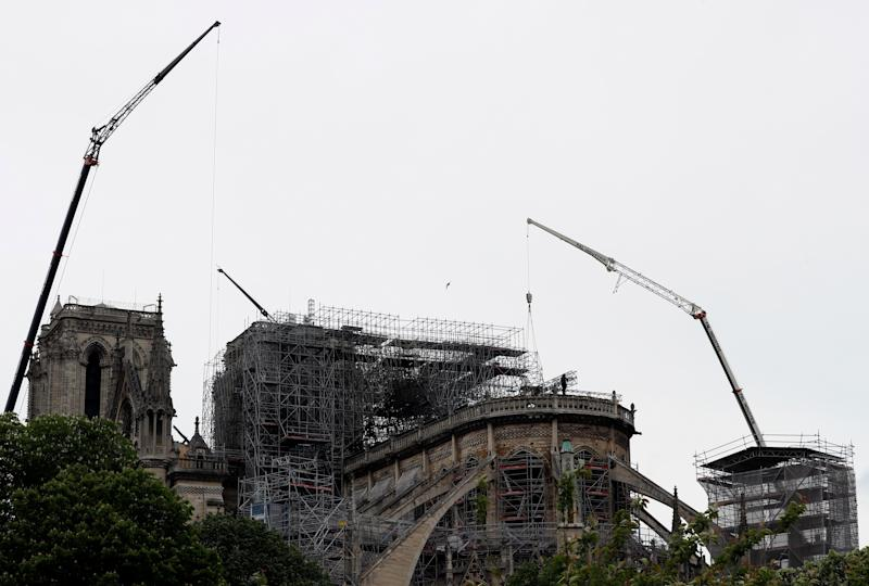 Notre-Dame's now mostly-destroyed roof was made of wood, and included some of the original beams erected in the 12th century. Source: AP