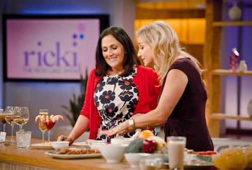 "This Thurs., July 26, 2012 photo released by 20th Television shows host Ricki Lake, left, and physician nutrition specialist, Dr. Melina Jampolis, during the second day of taping for her new daytime talk show, ""The Ricki Lake Show."" The TV show debuts Monday, Sept. 10, 2012, bringing the talk show host back to daytime TV. (AP Photo/20th Television, Barry J. Holmes)"