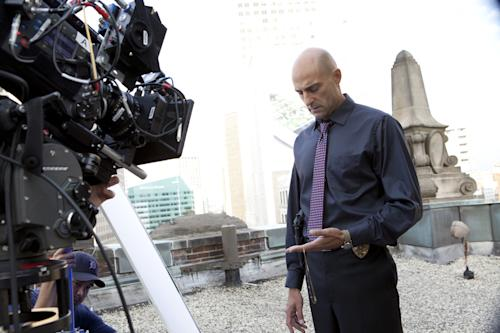 "This image released by AMC shows Mark Strong on the set of ""Low Winter Sun."" The series, premiering Sunday, Aug. 11, revives a two-part U.K. miniseries from 2006. It also marks Hollywood's return to the Motor City as a place to explore crime, following ABC's ""Detroit 1-8-7."" It aired during the 2010-11 season. (AP Photo/AMC, Alicia Gbur)"