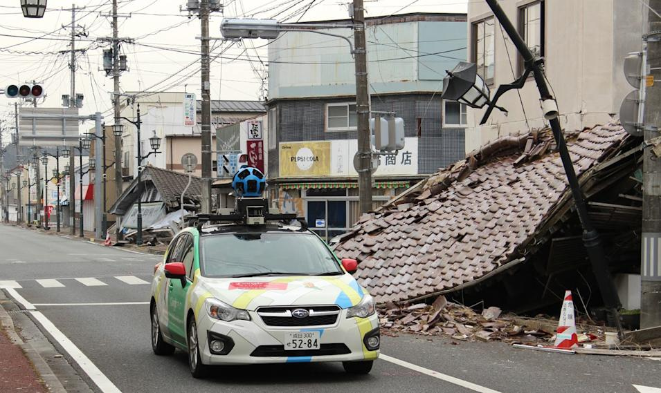 In this March, 2013 image released March 27, 2013, by Google, showing its camera-equipped vehicle as it moves through Namie town in Japan, a nuclear no-go zone where former residents have been unable to live since they fled from radioactive contamination from the Fukushima Dai-ichi nuclear power plant two years ago. Google Street View is giving the world a rare glimpse into Japan's eerie ghost town, following the March 2011 earthquake and tsunami which sparked a nuclear disaster that has left the area uninhabitable.  The photo technology pieces together digital images captured by Google's fleet of camera-equipped vehicles and allows viewers to take virtual tours of locations around the world, including faraway spots like the South Pole and fantastic landscapes like the Grand Canyon, or in this case deserted townscapes.(AP Photo/Google) EDITORIAL USE ONLY