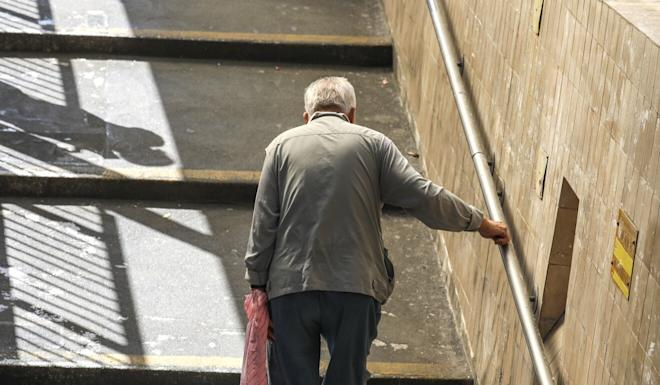 An elderly man walks in Sham Shui Po district in January. Photo: Nora Tam