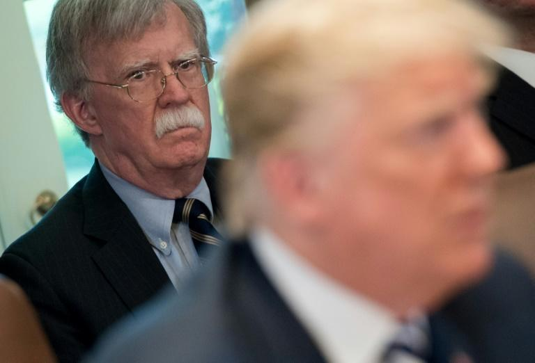 Former US national security advisor John Bolton (L, pictured May 2018) is set to release a tell-all book that contains many damning allegations against US President Donald Trump