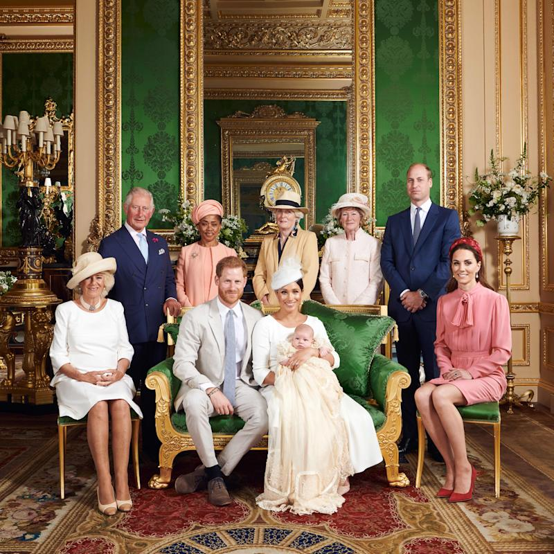 This official handout Christening photograph released by the Duke and Duchess of Sussex shows Britain's Prince Harry, Duke of Sussex (centre left), and his wife Meghan, Duchess of Sussex holding their baby son, Archie Harrison Mountbatten-Windsor flanked by (L-R) Britain's Camilla, Duchess of Cornwall, Britain's Prince Charles, Prince of Wales, Ms Doria Ragland, Lady Jane Fellowes, Lady Sarah McCorquodale, Britain's Prince William, Duke of Cambridge, and Britain's Catherine, Duchess of Cambridge in the Green Drawing Room at Windsor Castle, west of London on July 6, 2019. - Prince Harry and his wife Meghan had their baby son Archie christened on Saturday at a private ceremony.