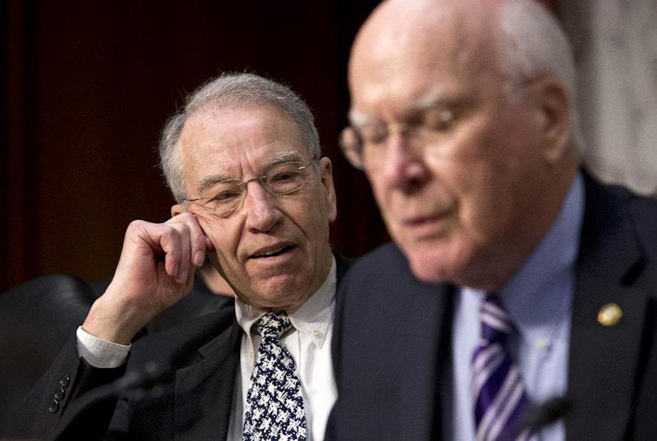 Sen. Chuck Grassley, R-Iowa, ranking member on the Senate Judiciary Committee, left, pauses after a brief but heated response to remarks by Sen. Chuck Schumer, D-N.Y., not pictured, during the committee's hearing on immigration reform, Monday, April 22, 2013 on Capitol Hill in Washington. Committee Chairman Sen. Patrick Leahy, D-Vt. is at right.  (AP Photo/J. Scott Applewhite)