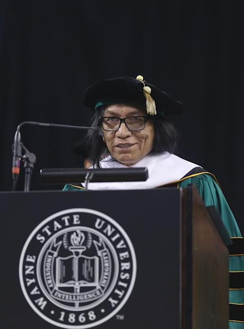 "Musician Sixto Rodriguez addresses the Wayne State University commencement ceremony after receiving a Doctor of Humane Letters honorary degree, Thursday, May 9, 2013 in Detroit, during the university's commencement ceremony. Rodriguez's two albums in the early 1970s received little attention in the United States but he unknowingly developed a cult following in South Africa during the apartheid era. He was the subject of an Oscar-winning documentary, ""Searching for Sugar Man."".(AP Photo/Carlos Osorio)"