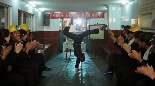 """In this image made out of film """"Comrade Kim Goes Flying"""" released by Another Dimension of An Idea/Koryo Group, Comrade Kim Yong Mi played by Han Jong Sim, center, receives applause from her coal mine comrades for her acrobatic performance. It's a classic tale of a small town girl who follows her dreams to the big city. But in this case, the girl is a North Korean coal miner, the big city is Pyongyang and her dream is to become a high-flying trapeze artist. """"Comrade Kim Goes Flying,"""" a collaboration between a North Korean director and two European filmmakers, makes its world premiere Saturday, Sept. 8, 2012 at the Toronto International Film Festival before it heads to Pyongyang later this month for its North Korean debut. (AP Photo/Courtesy of Another Dimension of An Idea/Koryo Group) EDITORIAL USE ONLY"""