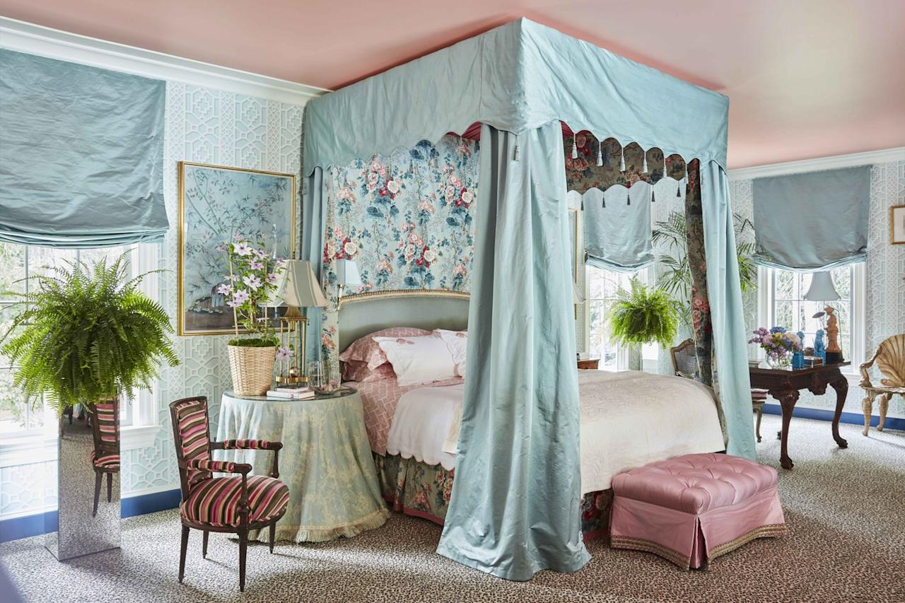 """<p>With trellis-patterned wallpaper,  floral chintz fabrics and a ceiling painted in a soothing pink, designer <a href=""""https://danielledrollins.com"""" target=""""_blank"""">Danielle Rollins</a> created a fanciful backdrop for the main bedroom in her Atlanta home. The curtains and bed canopy are in a <a href=""""https://www.kravet.com/brunschwig-fils"""" target=""""_blank"""">Brunschwig & Fils</a> aqua satin. </p>"""