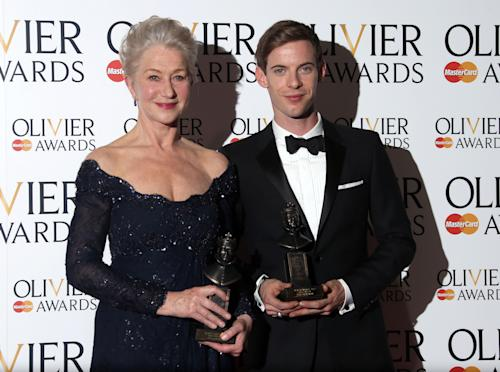 Helen Mirren winner of Best Actress Award for The Audience and Luke Treadaway winner of Best Actor Award for The Curious Incident of the Dog in the Night-time seen in the press room at the Olivier Awards 2013 at the Royal opera House in London on Sunday, April 28th, 2013. (Photo by Joel Ryan/Invision/AP)