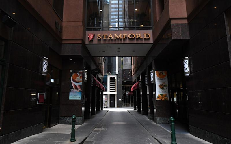 An outbreak was linked to the Stamford Hotel, used to quarantine infected people