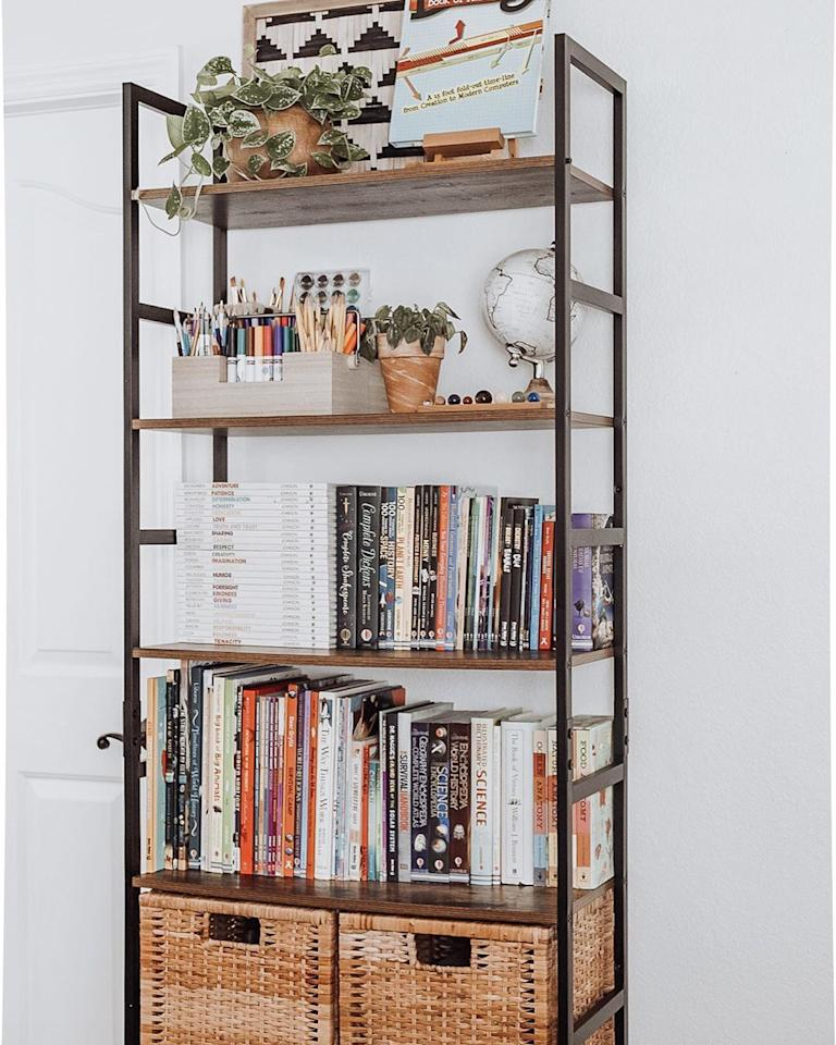 """<p>Clear a bookshelf that you already have to make room for workbooks, textbooks, art supplies, and bins. Let kids tuck their papers and other materials in the bins, so it doesn't take away from the overall display.</p><p><em><a href=""""https://www.instagram.com/p/CC_Nl0MlLxu/"""" target=""""_blank"""">See more at The Homely Homeschool »</a></em></p>"""