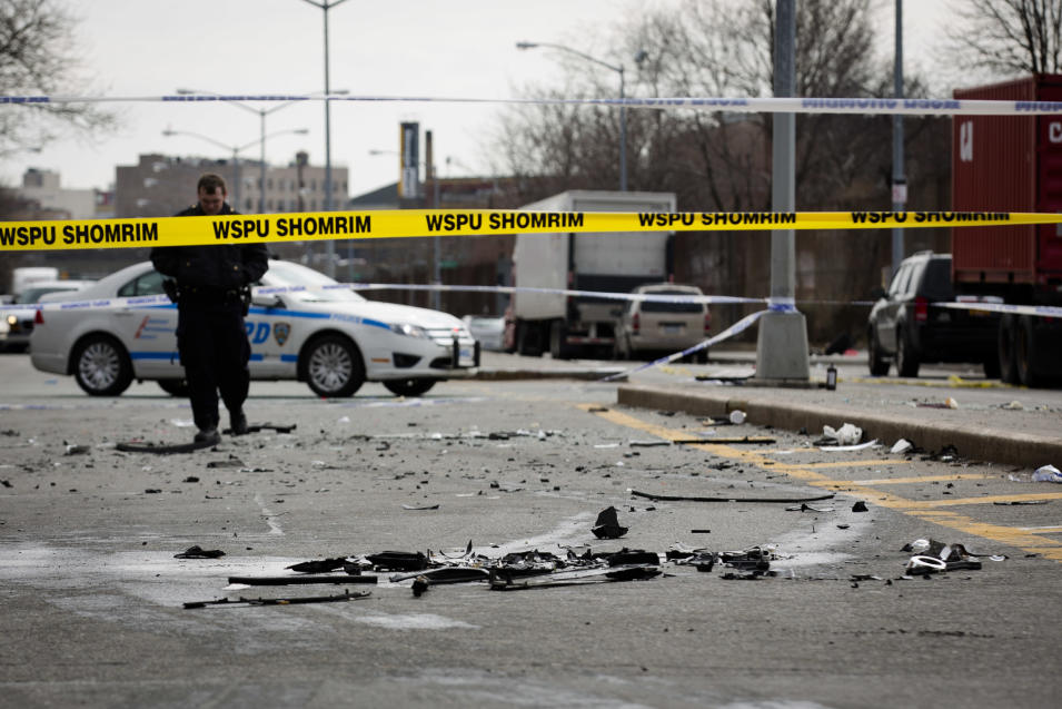 Debris from a fatal accident that claimed the lives of two expectant parents litter Kent Avenue, Sunday, March 3, 2013, in the Brooklyn borough of New York. A driver struck the car the couple were riding in early Sunday morning, killing both parents while their baby, whowas born prematurely, survivedand isin critical condition. (AP Photo/John Minchillo)