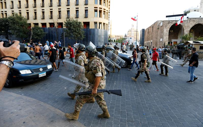 Lebanese Army soldiers are deployed during a protest in the aftermath of a blast, in Beirut, Lebanon - Thaier Al-Sudani/Reuters