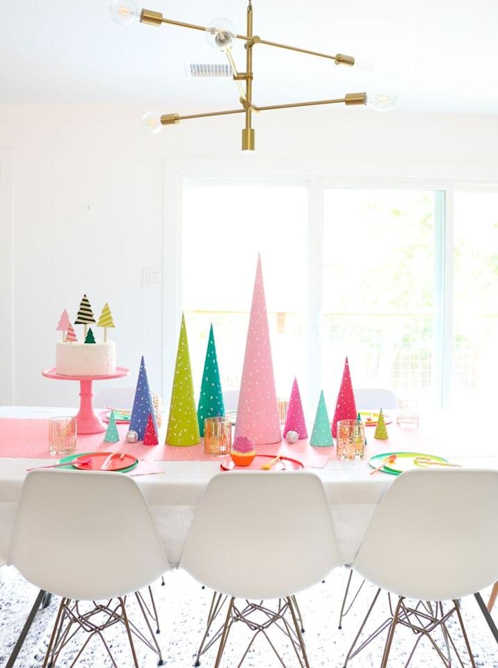 "<p>Whip up a forest of snow-dotted trees in any colors you like. Start with prefab paper mâche<em> </em>cones, and top with acrylic paint, dotted with white for a chic and modern-looking interpretation of snow.</p><p><em><a href=""https://akailochiclife.com/2018/11/diy-snow-dotted-cone-trees.html"" target=""_blank"">Get the tutorial at A Kailo Chic Life »</a></em><br></p>"