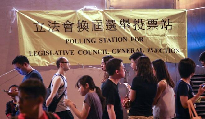 Voters queue up outside a Wan Chai polling station for Hong Kong's 2016 Legislative Council elections. Photo: David Wong
