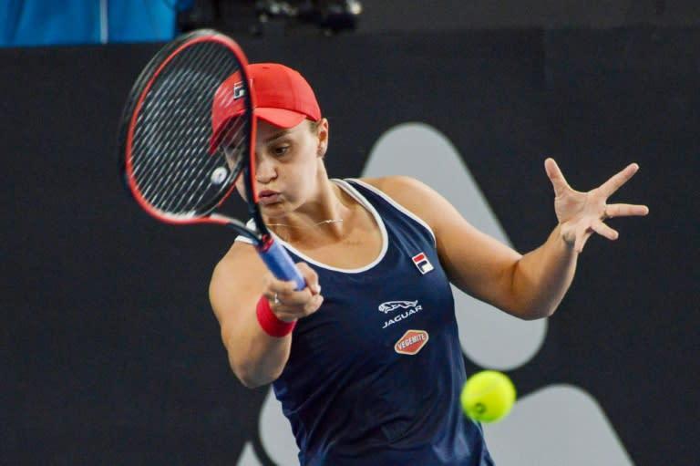 Ashleigh Barty of Australia hits a return against Marketa Vondrousova of the Czech Republic during their women's quarter-final singles match at the Adelaide International
