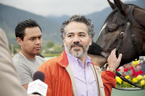 "In this undated image provided by HBO, John Ortiz appears in a scene from the HBO original series ""Luck."" The sport of horse racing is determined to endure the inevitable deaths of its injury-prone animals. But Hollywood has proved it lacks the stomach for it. The HBO TV channel ended the racing series ""Luck"" after three horses used in the realistic production were injured and euthanized over a period stretching from 2010 to last week. (AP Photo/HBO, Gusmano Cesaretti)"