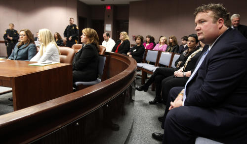 "Mark Bovenizer, right, the husband of frormer ""Melrose Place"" actress Amy Locane-Bovenizer, 40, of Hopewell Township, looks toward the Superior Court Judge Robert Reed, as the jury returns a verdict on Tuesday, Nov. 27, 2012 in Somerville, N.J. The jurors convicted Amy Locane-Bovenizer of vehicular homicide, but acquitted her of a more serious charge, aggravated manslaughter, in the 2010 accident that killed a 60-year-old woman. Somerset County prosecutors said Locane-Bovenizer's blood-alcohol level was nearly three times the legal limit when the crash occurred on a dark two-lane road in Montgomery Township. The defence conceded she was driving under the influence. But her lawyer claimed a woman was chasing her after an earlier accident, forcing her to speed. (AP Photo/The Star-Ledger, Robert Sciarrino, Pool)"