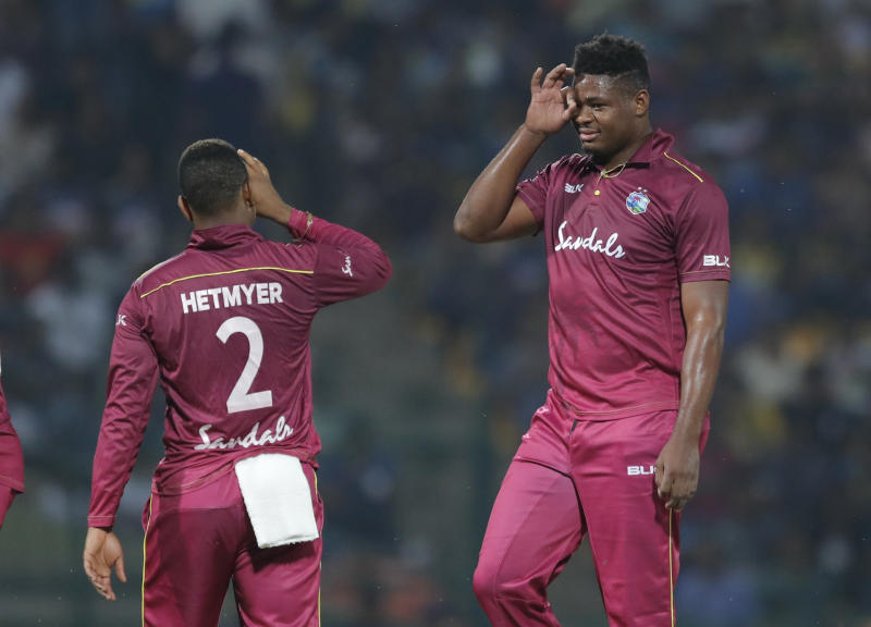 West Indies' bowler Oshane Thomas, right, gestures after taking the wicket of Shehan Jayasuriya during their first Twenty20 cricket match in Pallekele, Sri Lanka, Wednesday, March 4, 2020. (AP Photo/Eranga Jayawardena)