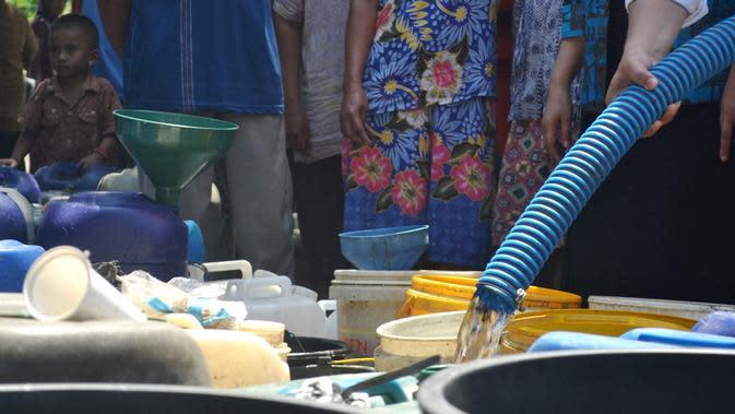 Ilustrasi bantuan air bersih. (Liputan6.com/Muhamad Ridlo)