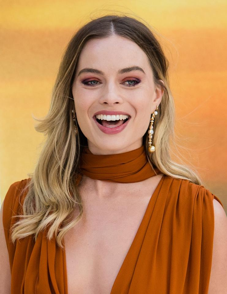 <p>Get the party started more quickly by keeping just the first few inches of your roots dark, then heading into a honey blonde shade, like <strong>Margot Robbie</strong>.</p>