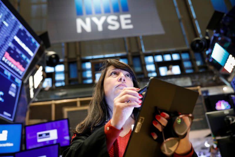 Stocks dip as trade worries halt record rally, dollar falls