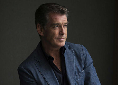"FILE - This Sept. 9, 2012 file photo shows actor Pierce Brosnan during a photo shoot to promote the movie ""Love is All You Need"" at the 2012 Toronto International Film Festival in Toronto. Brosnan's daughter Charlotte died in London on June 28, after battling ovarian cancer, his publicist confirms. She was 41. Brosnan's first wife Cassandra Harris, Charlotte's mother, also died from ovarian cancer in 1991. (AP Photo/The Canadian Press, Michelle Siu, File)"