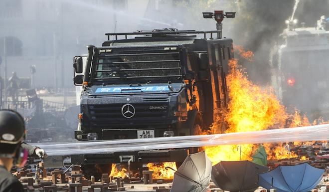 An armoured vehicle set on fire as clashes break out between riot police and radical protesters outside Polytechnic University in Hung Hom in November last year. Photo: Winson Wong