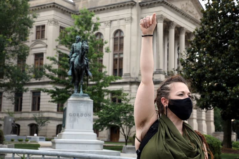 FILE PHOTO: People gather to protest confederate statues outside the Georgia State Capitol