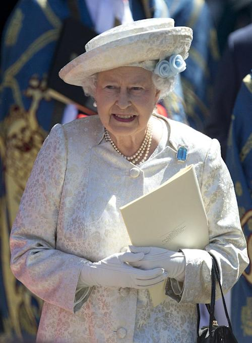 Britain's Queen Elizabeth II smiles as she waits for her car following a service to celebrate the 60th anniversary of her coronation at Westminster Abbey, London, Tuesday, June 4, 2013. (AP Photo/Alastair Grant)