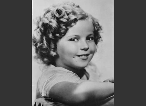 FILE - In this November 1936 file photo, 8-year-old U.S. American child movie star Shirley Temple is portrayed in Hollywood, Calif. Shirley Temple, the curly-haired child star who put smiles on the faces of Depression-era moviegoers, has died. She was 85. Publicist Cheryl Kagan says Temple, known in private life as Shirley Temple Black, died Monday night, Feb. 10, 2014, surrounded by family at her home near San Francisco. (AP Photo/File)