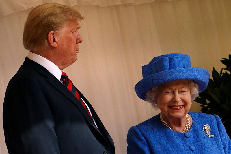"""US President Donald Trump speaks with Britain's Queen Elizabeth II after he inspected the Guard of Honour at Windsor Castle in Windsor, west of London, on July 13, 2018 on the second day of Trump's UK visit. - US President Donald Trump on Friday played down his extraordinary attack on Britain's plans for Brexit, praising Prime Minister Theresa May and insisting bilateral relations """"have never been stronger"""", even as tens of thousands protested in London against his visit. (Photo by Brendan Smialowski / AFP) (Photo credit should read BRENDAN SMIALOWSKI/AFP/Getty Images)"""