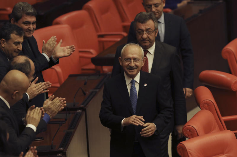 Kemal Kilicdaroglu, the leader of the main opposition Republican People's Party, arrives before Turkey's parliament authorized the deployment of troops to Libya to support the U.N.-backed government in Tripoli battle forces loyal to a rival government that is seeking to capture the capital, in Ankara, Turkey, Thursday, Jan. 2, 2020. Turkish lawmakers voted 325-184 at an emergency session in favor of a one-year mandate allowing the government to dispatch troops amid concerns that Turkish forces could aggravate the conflict in Libya and destabilize the region.(AP Photo/Burhan Ozbilici)