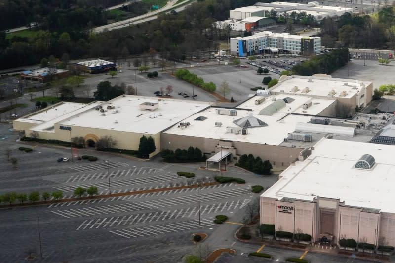 An empty mall parking lot is seen in Kennesaw