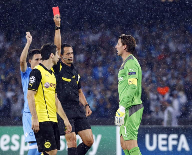 Referee Proenca shows red card to Borussia Dortmund's Weidenfeller during their Champions League Group F soccer match against Napoli in Naples