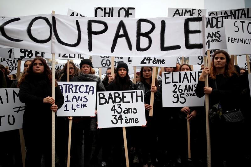 People attend a demonstration to protest femicide and violence against women in Paris