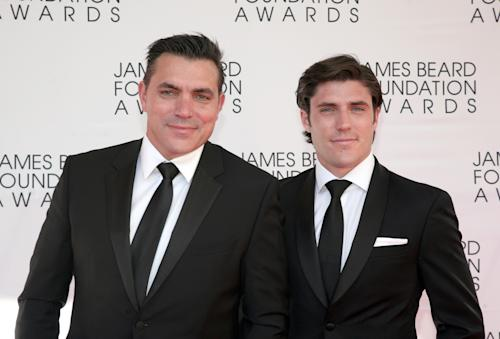 Restauranteur Todd English, left, with his son Oliver English, arrives at the James Beard Foundation Awards Gala on Monday, May 6, 2013, in New York. (Photo by Andy Kropa/Invision/AP)