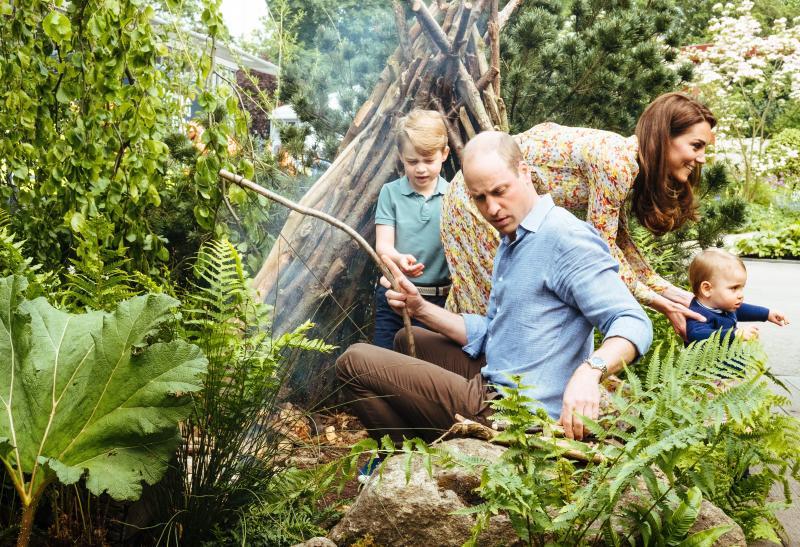 George and William gather sticks, as Kate guides a walking Louis [Photo: Matt Porteous]