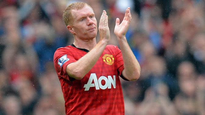 Paul Scholes - Lulusan dari akademi Manchester United yang dijuluki 'Class of 92' ini sempat pensiun pada Juli 2011. Hanya berselang enam bulan, gelandang kreatif ini diminta kembali memperkuat Setan Merah. (AFP/Andrew Yates)