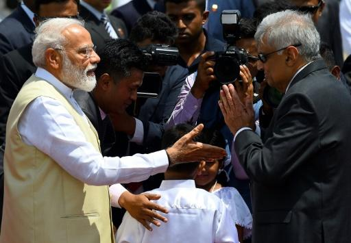 Sri Lankan Prime Minister Ranil Wickremesinghe (right) welcomes Indian Prime Minister Narendra Modi at Bandaranaike International Airport in Katunayake