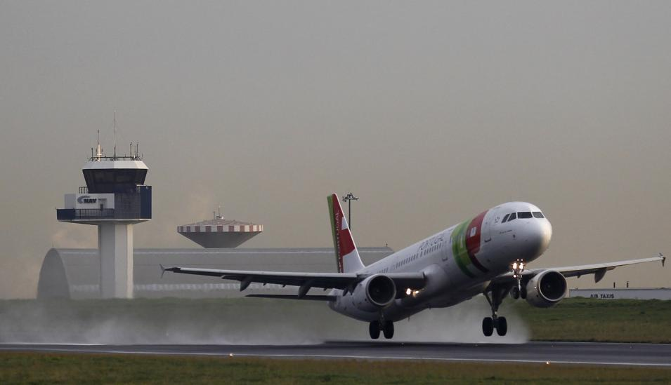 An Airbus jet of TAP Portugal airlines takes off in Lisbon airport