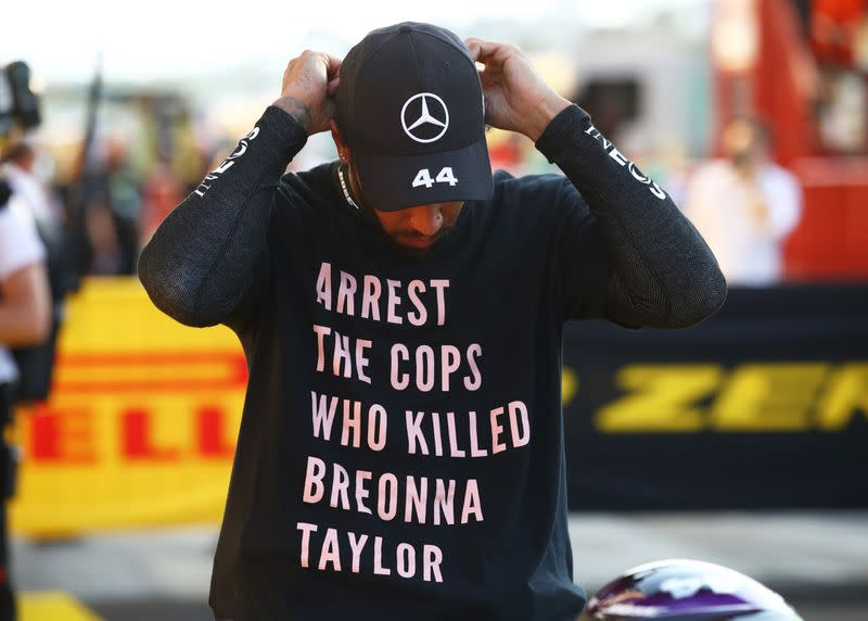 Hamilton takes a knee in 'Arrest the Cops' T-shirt